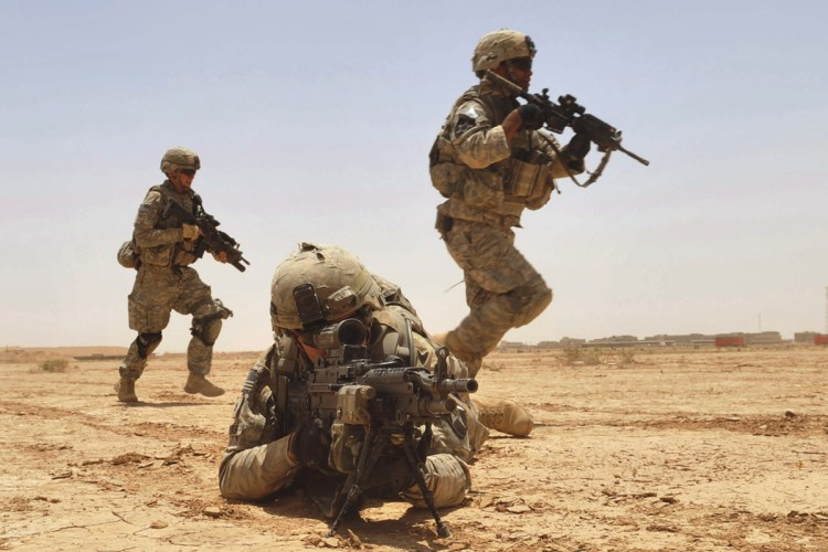 100627-N-6903G-203 U.S. Army Pfc. Robert Parker (2nd from left) provides fire support for his squad members during a live-fire exercise at the Kirkush Military Training Base in the Diyala province of Iraq on June 27, 2010. During the exercise, U.S. and Iraqi forces trained to clear mined wired obstacles, bunker complexes and on reacting to contact. Parker is assigned to Alpha Company, 5th Battalion, 20th Infantry Regiment, 2nd Infantry Division. DoD photo by Petty Officer 2nd Class Ted Green, U.S. Navy. (Released)