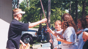 Fishing Poles were given away by Waynedale News representative, Alex Cornwell at the Waynedale Memorial Park during Waynedale Daze.