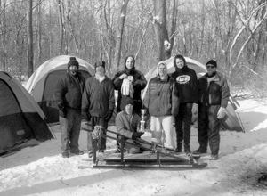Troop 344's Victorious 2004 Klondike Derby Team (L - R) Scoutmaster Bob Rainwaters, Scouts Karl McOmber, Joe Wilder, Joe Baumgardner, Zach Firestone, and Assistant Scoutmaster Gary McOmber. Sitting - Scout Randy Brautsch with 1st Place Trophy