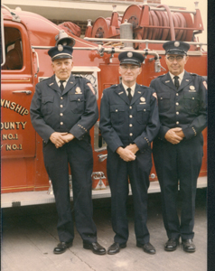(l-r) Captain James Mason, Delmar Green, and Kenneth McCague pose in front of pumper truck that carried over 1400 gallons of water. Below-right is the tanker truck built by James Mason and volunteers.