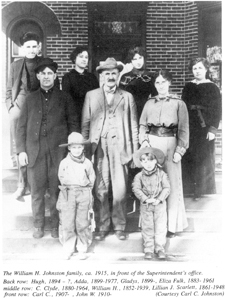 (photo courtesy of Carl C. Johnston) The William H. Johnston family, ca. 1915, in front of the Superintendent's office. Back row: Hugh, 1894-?; Adda, 1899-1977; Gladys, 1899-?; Eliza Fulk, 1883-1961. Middle row: C. Clyde, 1880-1964; William H., 1852-1939; Lillian J. Scarlett, 1861-1948. Front row: Carl C., 1907-?; John W. 1910-?.