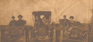 Published in the Fort Wayne Sentinel-?circa. The caption read: According to R. A. Prince, 2708 Lower Huntington Road, these were some of the first cars in Fort Wayne. His grandparents, George and Katharine Mason are on the right.
