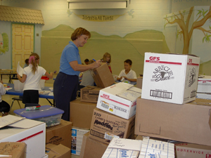 Canterbury School String Instructor Mrs. Lenelle Morse labels and organizes the many boxes of supplies ready for delivery to New Orleans hurricane devasted families now living in Baton Rouge, LA.