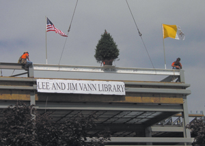 """The """"Topping Off Ceremony"""" included raising the tallest beam, complete with flags and a tree, on the Lee and Jim Vann Library and a speech by Jim Vann (right)."""