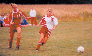 Paige Koomler of Wayne High School beats Adrienne Bigelow of Huntington North to the ball in Wayne's 5-0 victory on September 15, 2005.