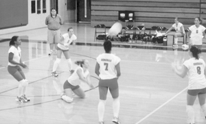 Members of the Wayne Lady Generals' Volleyball Team include: #4 Brittney Kennedy, #2 Jamie Pyle, #7 Aquaysha Kyles, #12 Kelsea Jackson (on bench), #6 Kristie Wyss, #8 Emily Osburn, #10 Ashlee Baker (digging for the ball) and #1 Lindsay Reighter (not shown).
