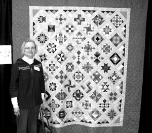 """Janet Levihn and her quilt """"More pink than brown"""""""