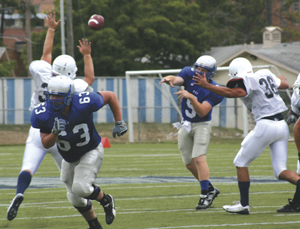 Quarterback Shaine Tierney throws a pass during scrimmage against Trine University, Tuesday, August 24, 2010. The next game will be Head Coach Kevin Donley's 350th of his college coaching career. He's won 236!