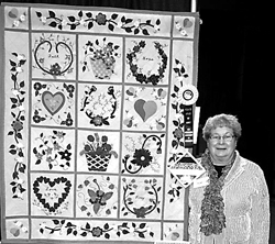 """Jacque Eriks and her award winning quilt """"Ewe-Niquely Baltimore""""."""