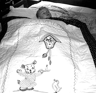 """Connor sleeps beneath his """"Good Night"""" quilt a gift from late Great-aunt Judi."""