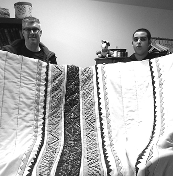 Joe Salem and his son Eli were delighted when they picked up their newly restored Jordanian quilt.