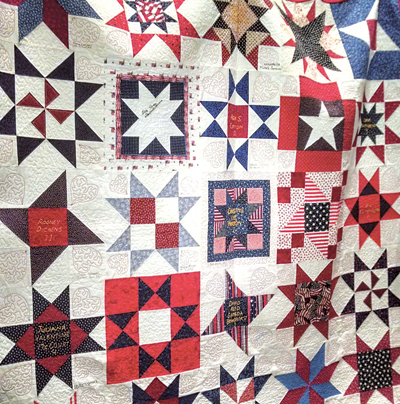 People from around the world created star quilt blocks to commemorate the lives lost on 9/11. ~ Photo credit: Jake Hornbarger