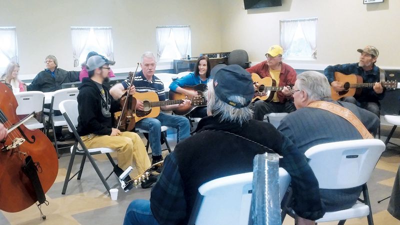 PICKIN' AND GRINNIN' AT THE CONSERVATION CLUB
