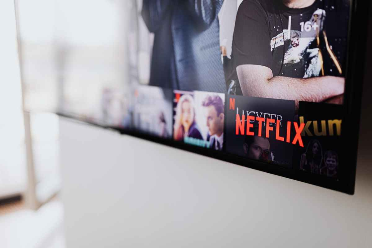 black flat screen tv turned on showing man in black shirt