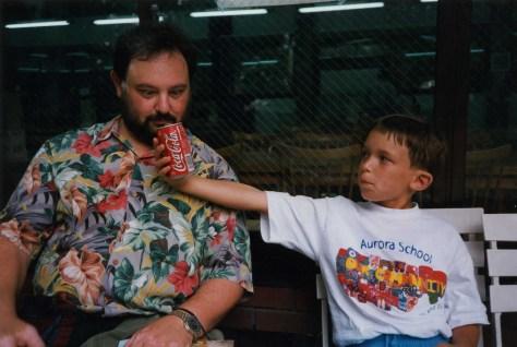 Ben hands Dad a coke