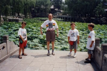 Boys at lily pond with Prof. Wang