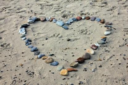heart stones on beach