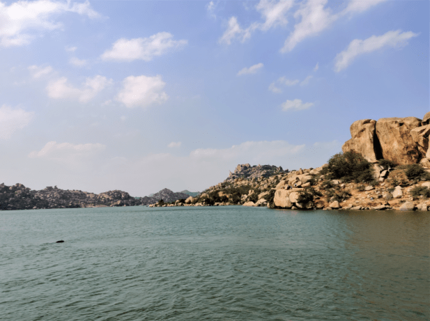 swimming at sanapur lake hippie island hampi