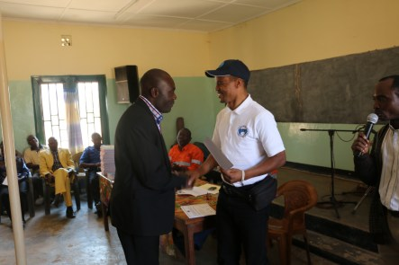 Mr. Ntala congratulating a principal.