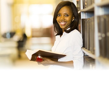 Young woman smiling in library