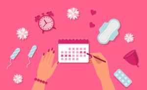 tampons, pads, clock, calendar on pink background