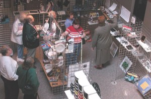A group of people looking at items on shelves.