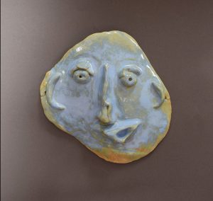 a mask out of blue clay