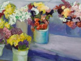 Several vases hold bright-colored floral arrangements on a step.