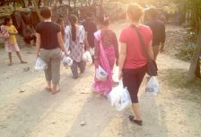 Delivering food bags to those on the riverbed.