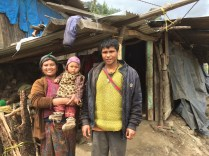 Pastor Prem and his family outside their makeshift home
