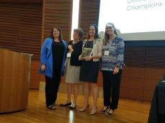 Jennifer Wegner, Pat Schramm, Bridget Willey and Sherrie Stuessy post after the award ceremony.