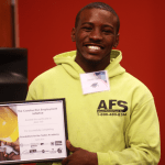 Graduate of Foundations for the Trades Academy, Javon Solis, holding his completion certificate at the graduation event.