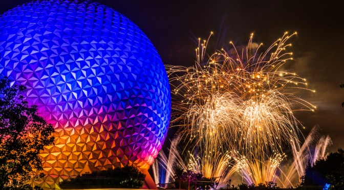 IllumiNations fireworks explode in the sky behind Spaceship Earth.