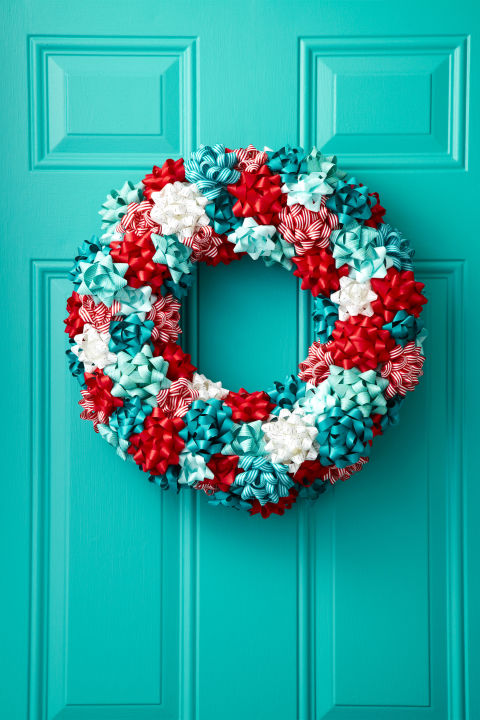 To turn store-bought bows into a jolly wreath, first attach a loop of floral wire (for hanging) around a 16