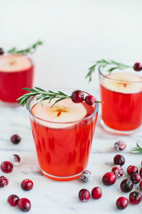 Cranberry juice gives this drink its gorgeous hue; garnish with a rosemary cranberry sprig for a festive touch. Get the recipe at Say Yes.