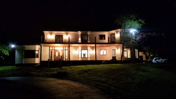 we bought the farm main house at night