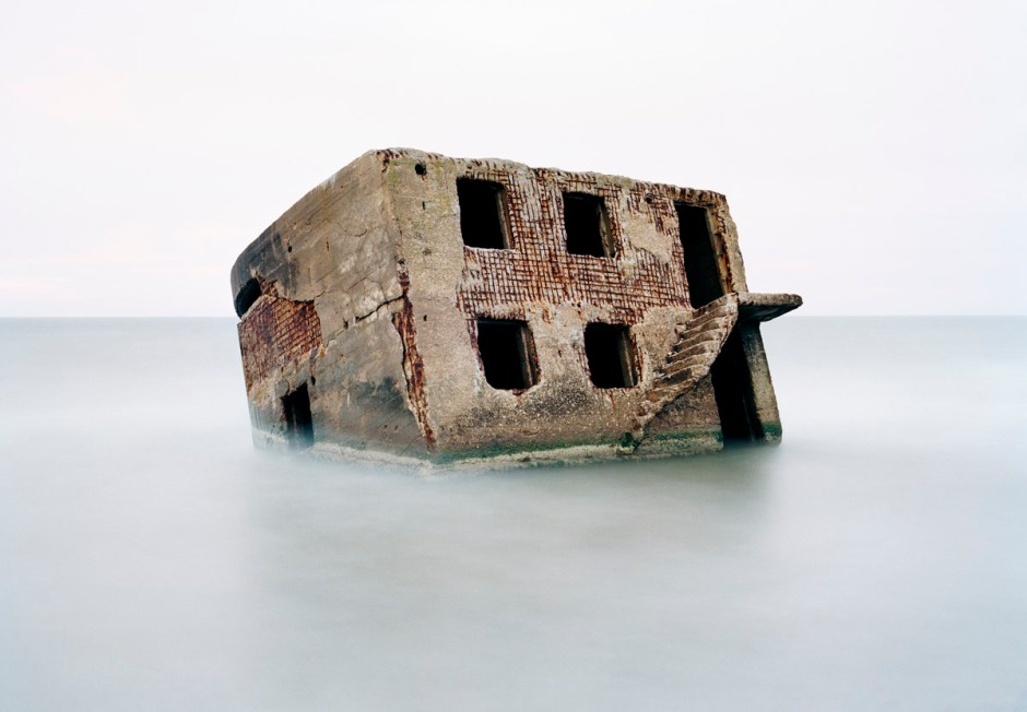 PRESS PHOTO ONLY TO BE USED IN RELATION WITH EXHIBITION RELICS OF THE COLD WAR IN DHM, BERLIN 2016. CUTTING PICTURES IS NOT ALLOWED. Latvia, Liepaja. At the former Soviet naval base Liepaja an old bunker lies in the Baltic Sea. Photo: Martin Roemers