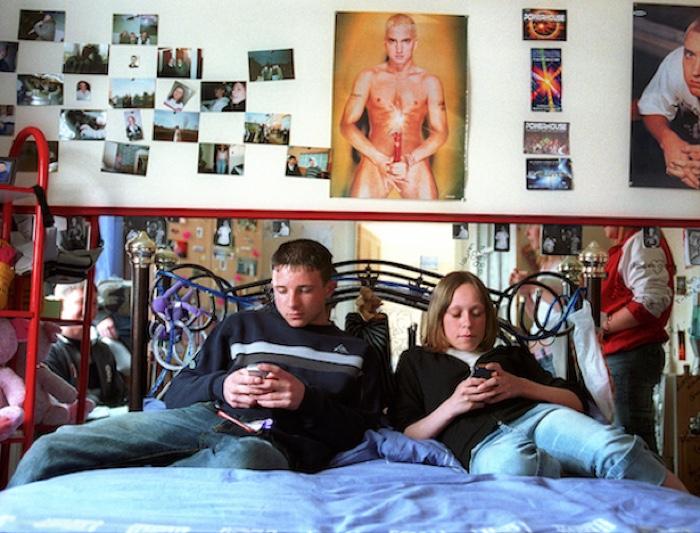 text messaging in Lorianne's bedroom. Thornley, Co.Durham Summer 2004 ©Karen Robinson