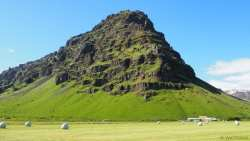 Green moss, blue skies, black rock, tan lichen, white ice -- a contrast of colors in Iceland