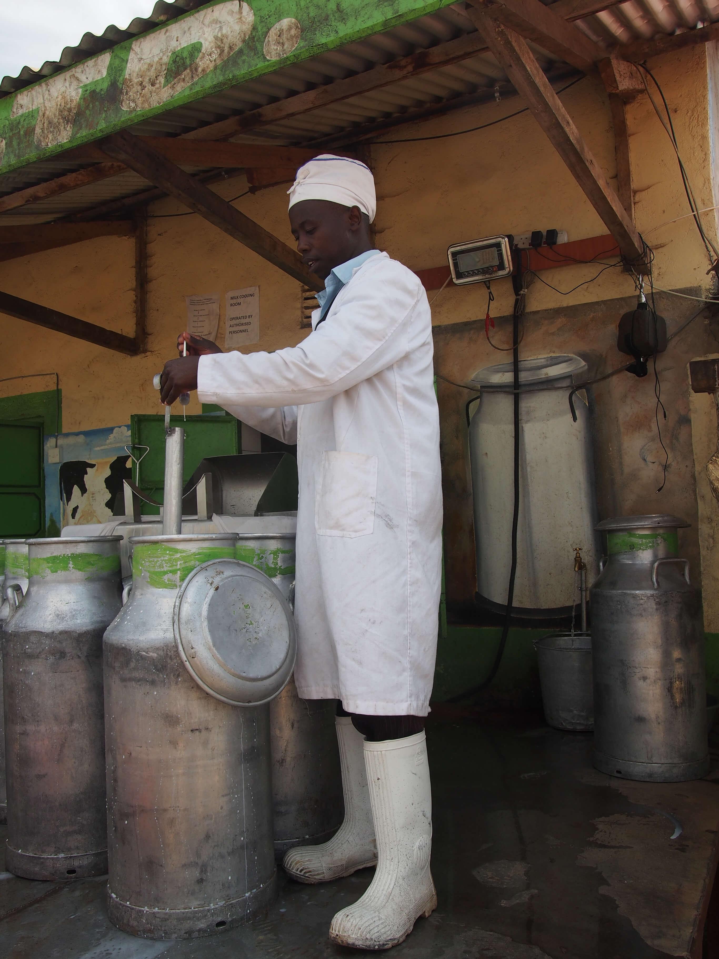 Man testing milk in Kenya