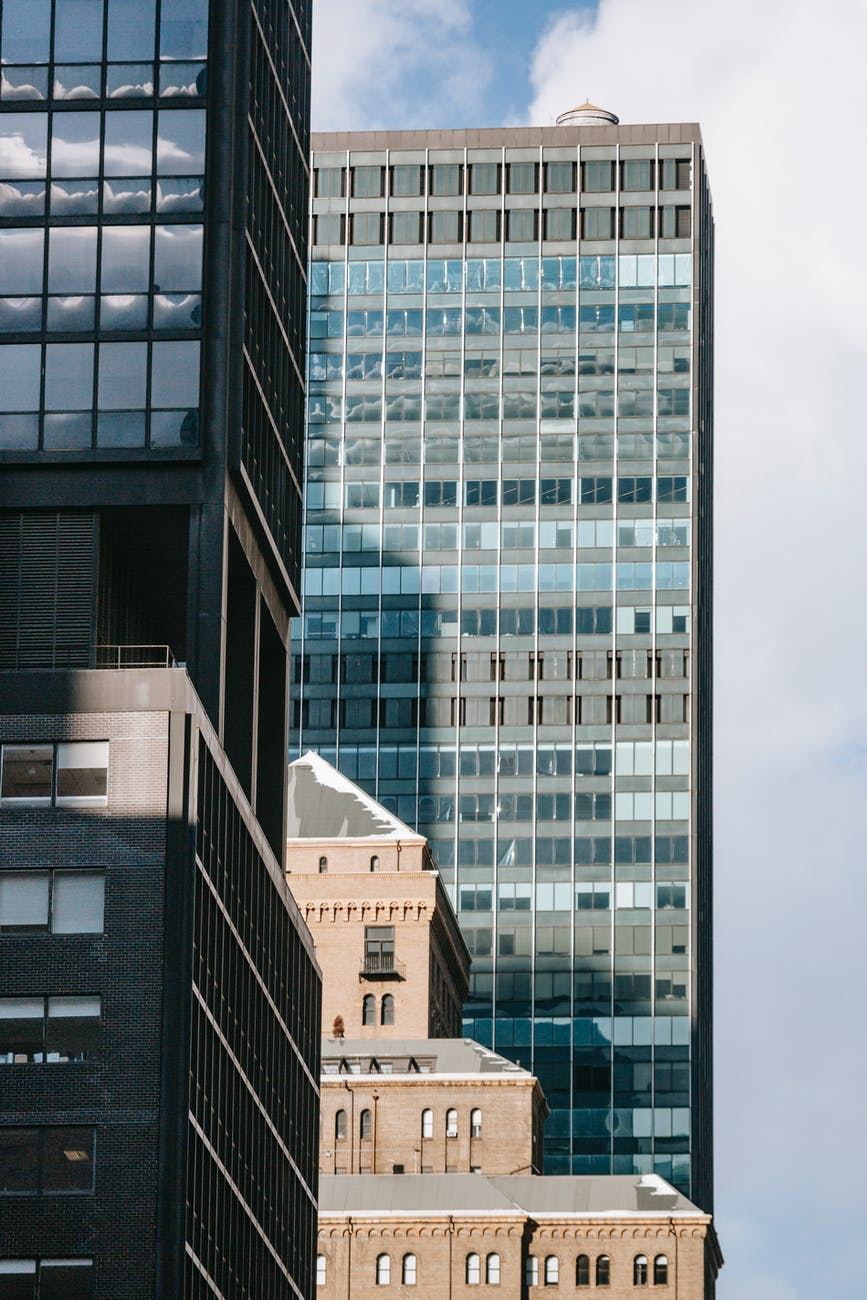 contemporary glass buildings under tranquil cloudy sky