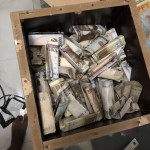 Twitter user shares photos of N165K he was able to save in his piggy bank in less than four months