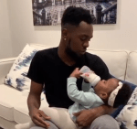 DaddyDuties! Patoranking Shares Video of himself bottle-feeding his Adorable daughter (Video)