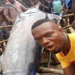 Nigerian Man caught Blue Marlin fish which is worth $2.6m and ate it with his Village People