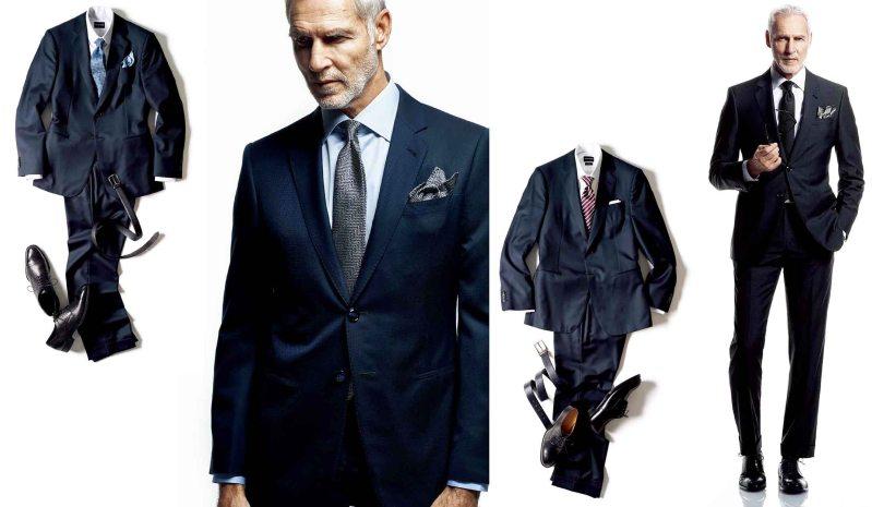 アルマーニ(ARMANI)のジョルジオ アルマーニのネイビーとブラックスーツを着用する外国人の男性