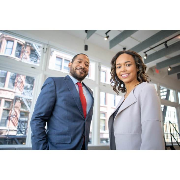 How to develop better self-esteem |  A couple of  young entrepreneurs are looking with a smile & confidence at the camera