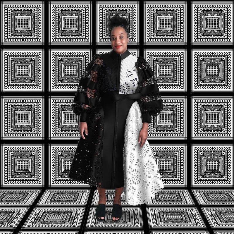 Aja Barber in an Anyango Mpinga black and white dress