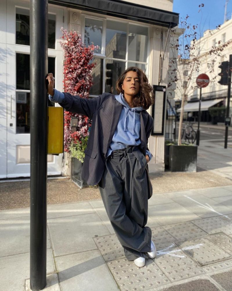 @its.arooj in relaxed trousers