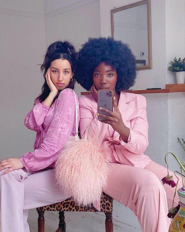 michelleamo_ wearing pastel pink suit.
