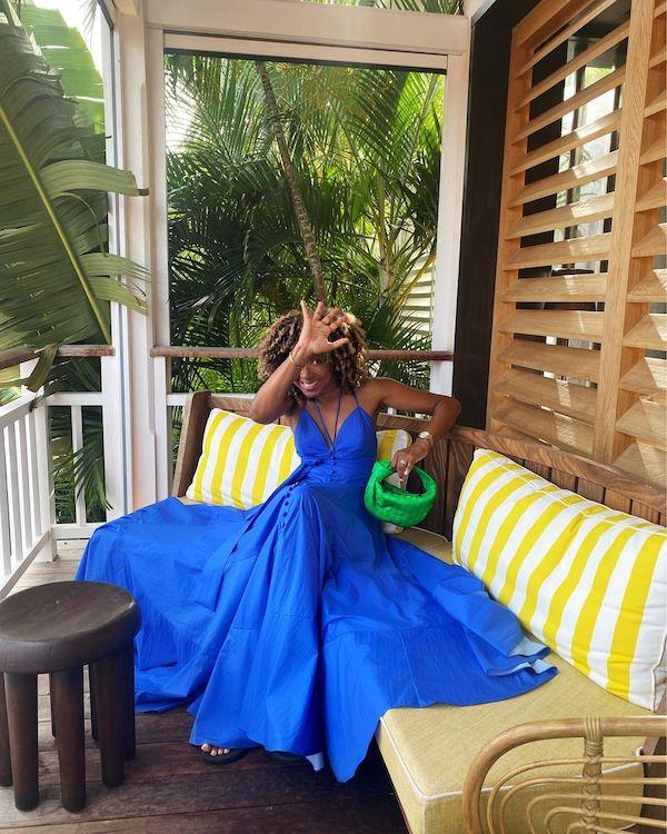 Karen Britchick wearing statement green Bottega Veneta bag and blue maxi dress